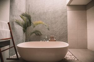 A stunning stone bathtub in muted pink bathroom