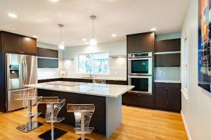 A remodeled kitchen with a sleek island in the middle