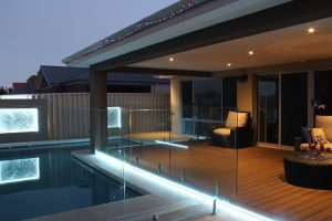 Ambient lighting in the wooden pool deck area