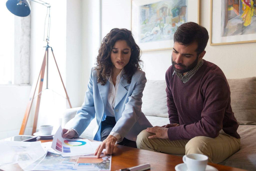man and woman discussing Home Remodeling Houston